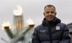 Tom Steitz poses for a photo in front of the Olympic cauldron at the Vancouver 2010 Olympics